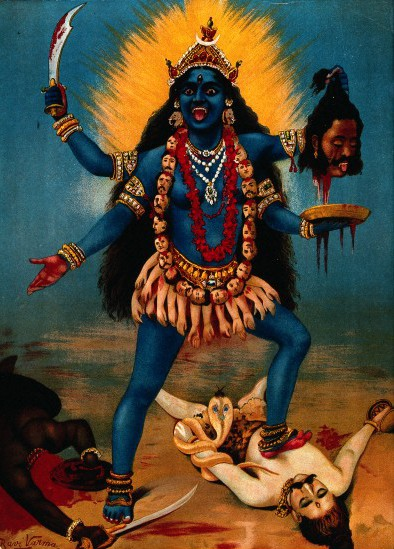 Kali standing on Shiva and holding decapitated head of demon